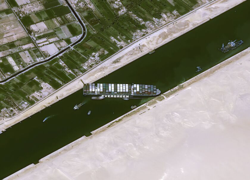 Overhead view of the cargo ship Ever Given stuck sideways in the Suez Canal.