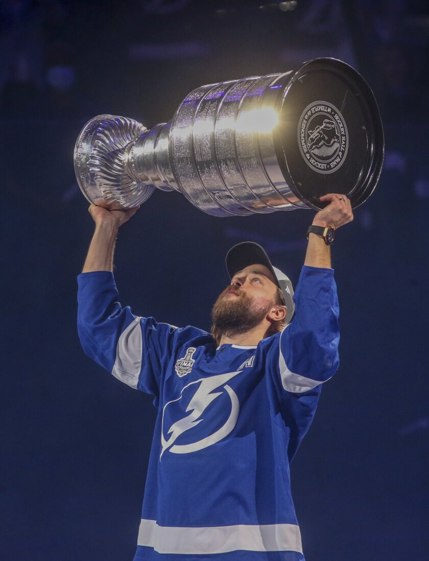 Tampa Bay Lighting's Victor Hedman carries the Stanley Cup while skating around Amalie Arena, Tuesday, Sept. 29, 2020, in Tampa, Fla. (Dirk Shadd/Tampa Bay Times via AP)