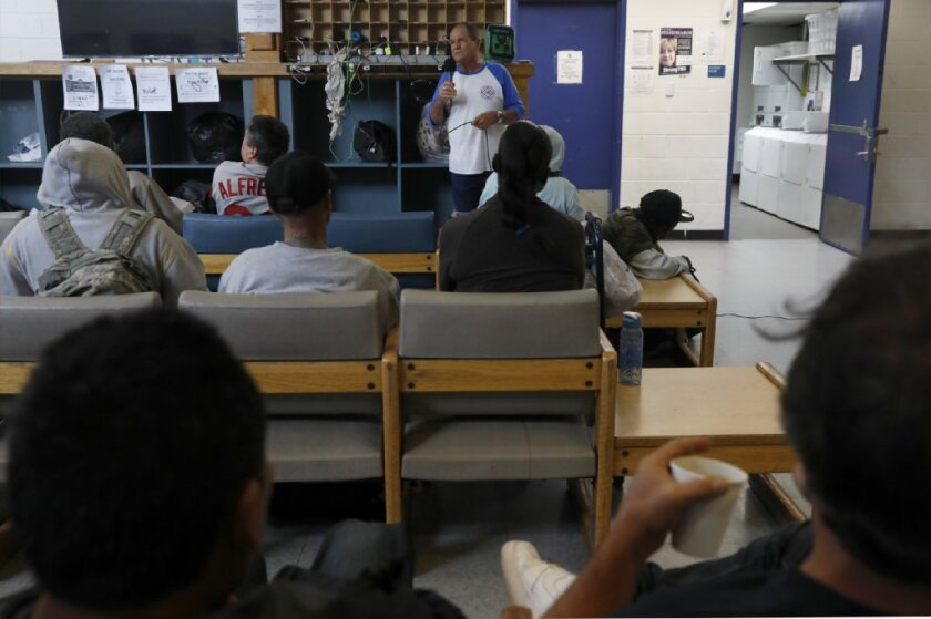 """Paul F., 71, a recovering addict, talks with attendees of the """"Are You Done?"""" program, an outreach sponsored by Father Joe's Villages, at the Neil Good Day Center Thursday."""