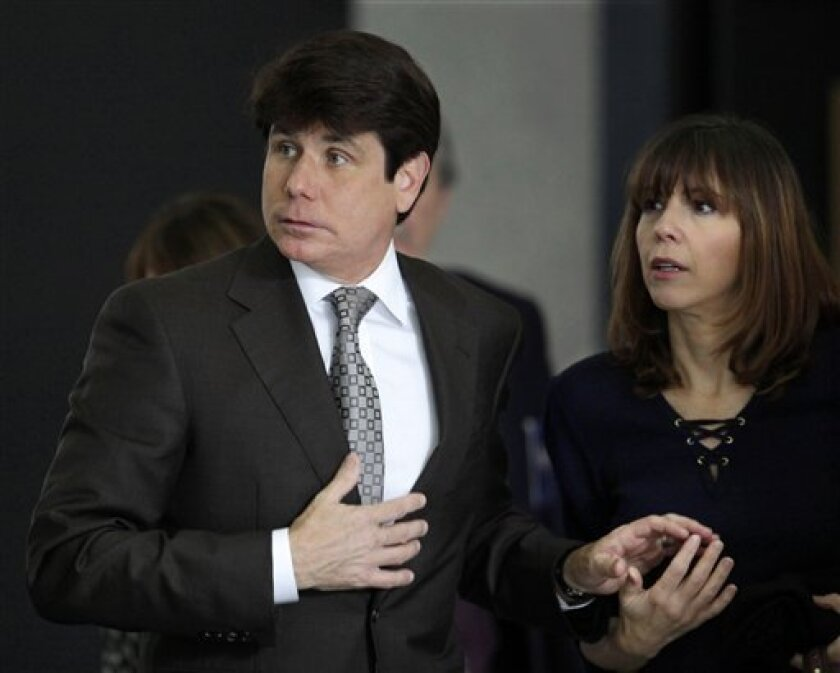 Former Illinois Gov. Rod Blagojevich, left, and his wife Patti join hands as they enter the Federal Court building Friday, June 4, 2010 in Chicago, for the second day of jury selection in his federal corruption trial. (AP Photo/M. Spencer Green)