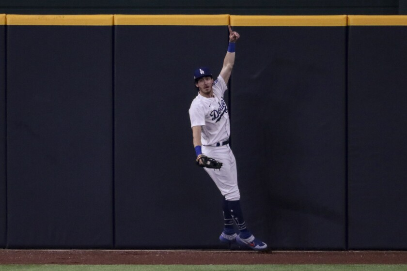 Dodgers center Cody Bellinger celebrates after making a catch to prevent a home run by San Diego's Fernando Tatis Jr.
