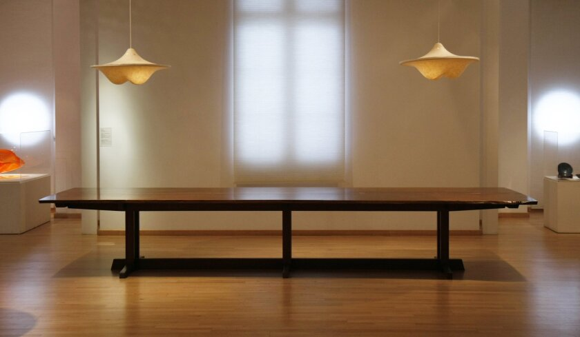 The Mingei International Museum specially commissioned the table (14 1/2 feet long) from the New Hope, Pennsylvania furniture studios of George Nakashima (1905-1990). The tabletop is constructed of two matching pieces of black walnut with rosewood butterfly joints.