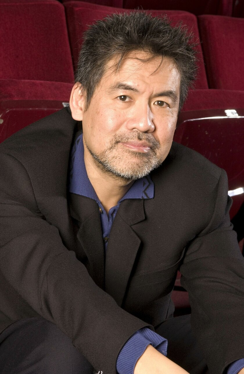 FILE- In this 2007 file photo, Tony-Award winning playwright David Henry Hwang is shown at The Public Theater in New York. Wang was a victim of a random attach while carrying groceries to his home in Brooklyn, N.Y: having been slashed so deeply that it severed an artery leading to the brain that required emergency surgery. Since December 2015, about a dozen such random, unprovoked slashings have been reported across the city, including three on subway trains during the week of January 25. (AP Photo/Jim Cooper, File)
