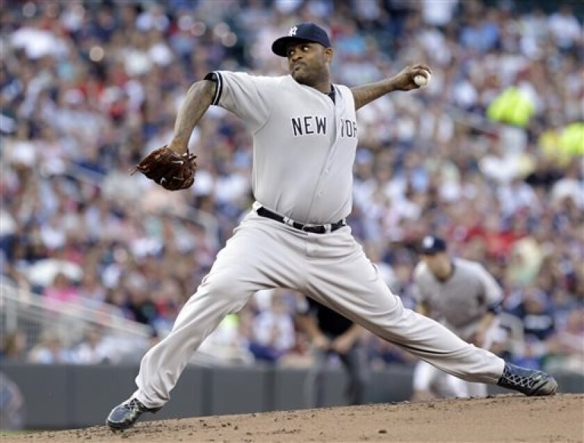 New York Yankees pitcher CC Sabathia throws against the Minnesota Twins in the first inning of a baseball game on Wednesday, July 3, 2013, in Minneapolis. (AP Photo/Jim Mone)