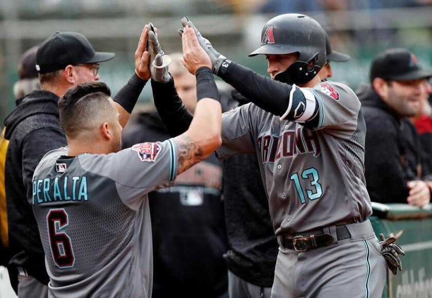 Arizona Diamondbacks Nick Ahmed (R) is greeted by Arizona Diamondbacks David Peralta (L) of Venezuela after hitting a solo home run off Oakland Athletics starting pitcher Sean Manaea during the first inning of their MLB game at the Oakland Coliseum in Oakland, California, USA, 25 May 2018. EFE