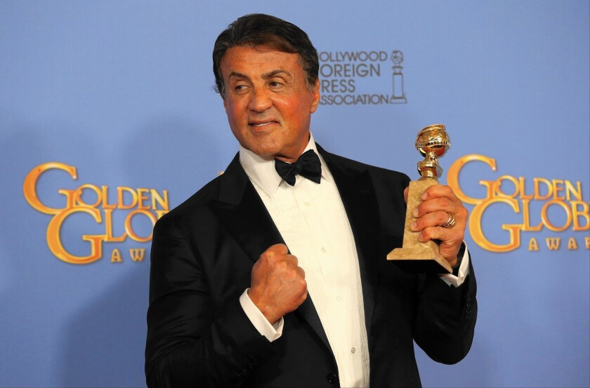 """Sylvester Stallone clutches the trophy he won for """"Creed,"""" revisiting a touchstone role."""