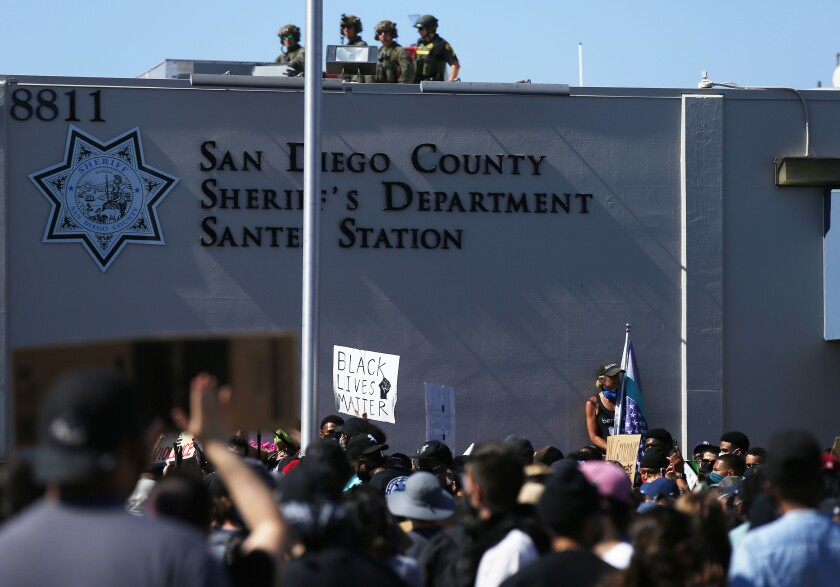 As Black Lives Matter supporters rallied at San Diego Sheriff's Dept. Santee Station deputies stood on its roof June 7.