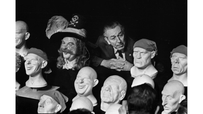 """Feb. 3, 1966: Walt Disney with some of the plastic heads for the new """"Pirates of the Caribbean"""" ride opening at Disneyland."""