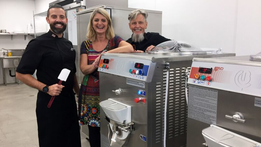 Gelato chef/instructor Filippo Cianciosi, left, owner Paola Richard and chief chemist Panther Wilde inside the kitchen at GelatoLove, which opened its first flavor lab, factory and retail shop Dec. 18 in the Carlsbad Gateway Center.