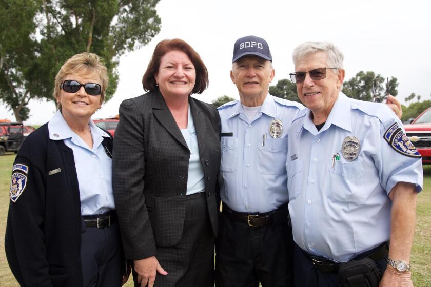 Police volunteer Dawn Cox, Senator Toni Atkins and Retired Senior Volunteer Patrol members Bob Sgambelluri and Ronald Harris
