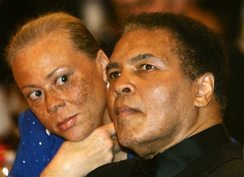 FILE - In this Dec. 17, 2005 file photo, boxing legend Muhammad Ali is watched by his wife, Lonnie,  during the award ceremony for the Otto-Hahn-Peace-Medal 2005 of the German Society of the United Nations in Berlin.The three-time heavyweight boxing champion will celebrate a milestone birthday Tues
