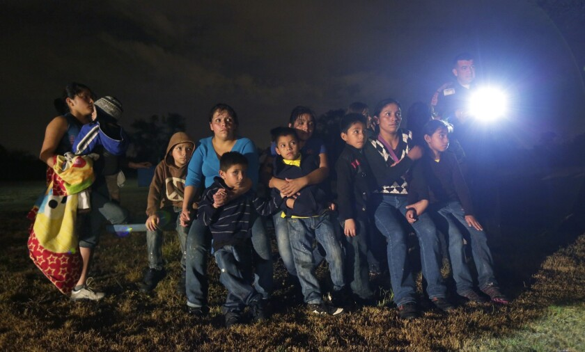 Immigrants from Honduras and El Salvador are detained in Texas last month.