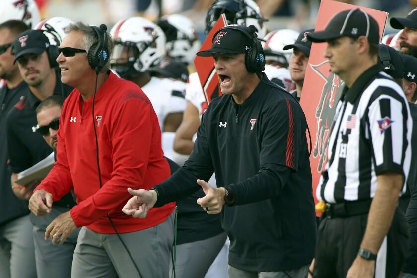Texas Tech coach Matt Wells reacts during the second half of an NCAA college football game against West Virginia in Morgantown, W.Va., Saturday, Oct. 2, 2021. (AP Photo/Kathleen Batten)