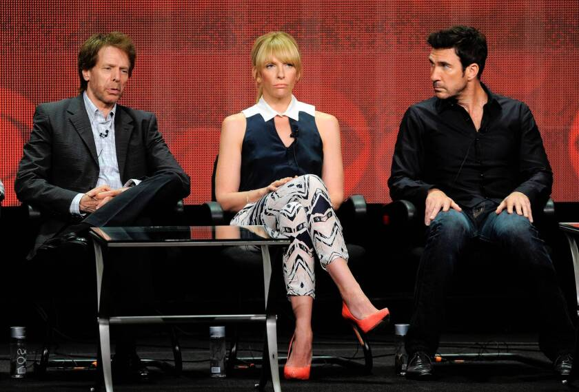 """Producer Jerry Bruckheimer, left, and actors Toni Collette and Dylan McDermott participate in the """"Hostages"""" panel at the TCA press tour."""