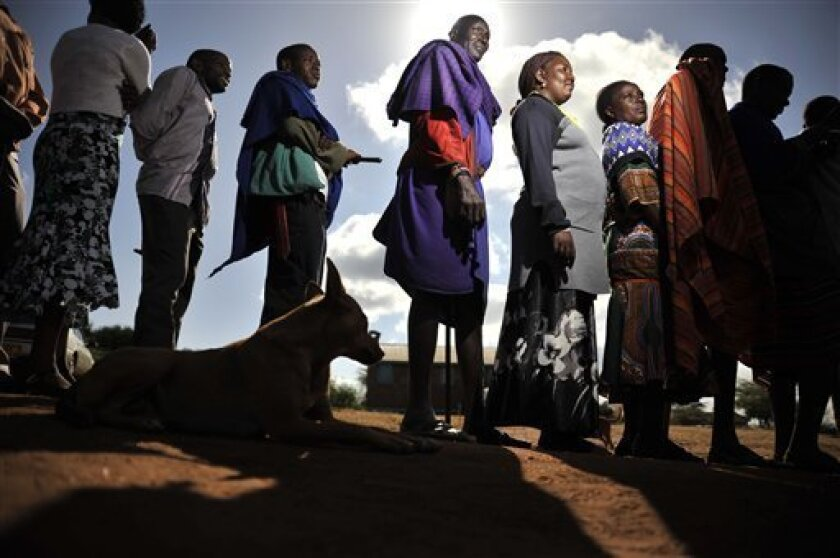Masaai line up to vote in a general election in Ilbissil, Kenya, Monday March 4, 2013. Five years after more than 1,000 people were killed in election-related violence, Kenyans went to the polls on Monday to begin casting votes in the nationwide election seen as the country's most important - and c