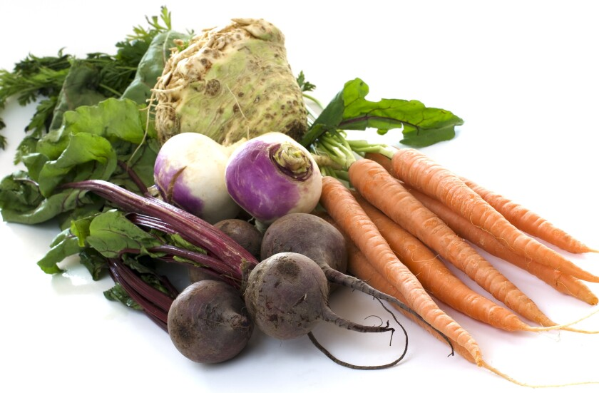 Various root vegetables on white background