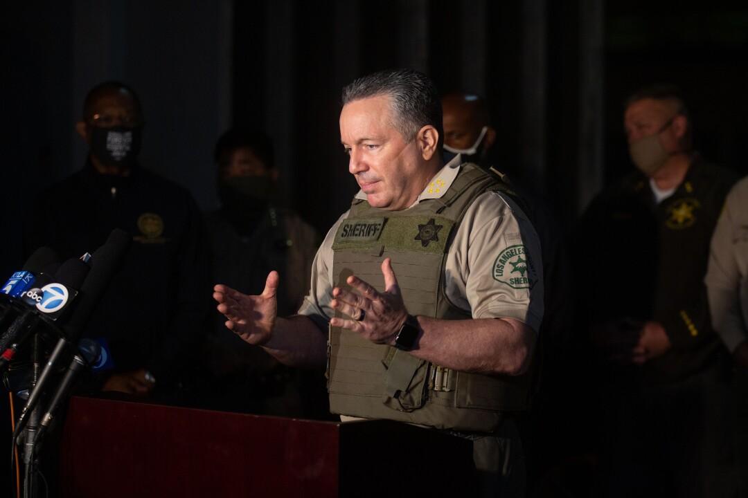 Sheriff Alex Villanueva address the media during a news conference.