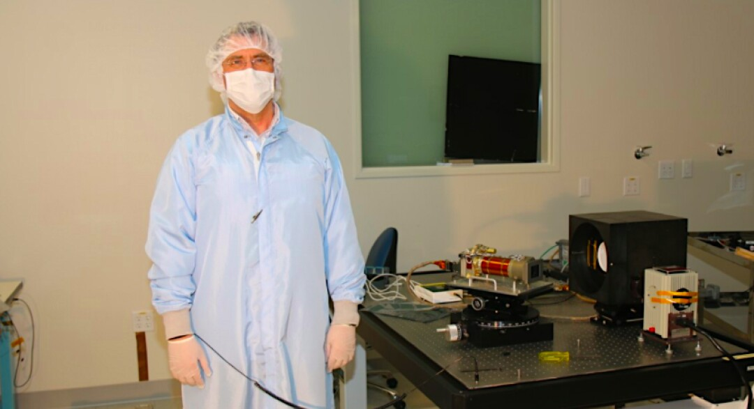Mike Ravine, advanced project manager at MSSS, stands next to a Mastcam-Z camera.