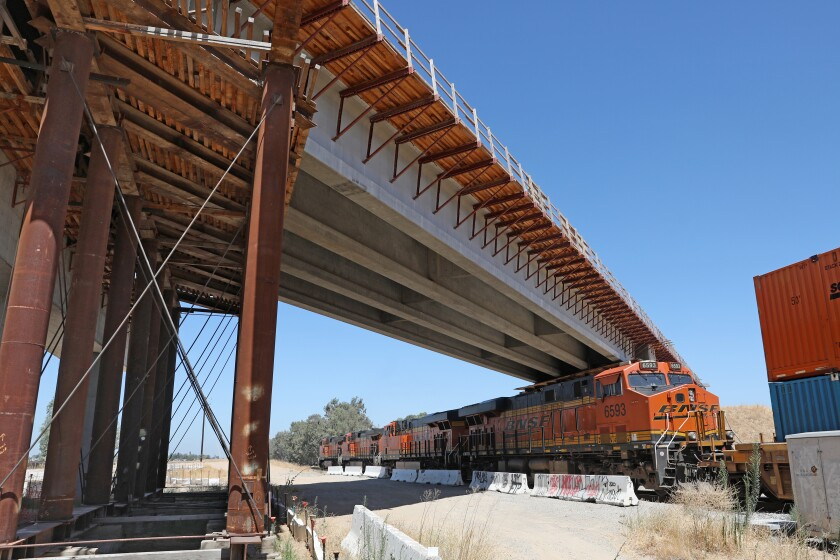 MADERA, CA - AUGUST 05: A 700 foot bullet train bridge across Road 27, between Road 27 and Club Dr., and the BNSF main line in Madera County had a serious problem with corroded tension strands that broke in December 2019, on Wednesday, Aug. 5, 2020 in Madera, CA. The California High-Speed Rail Authority is making repairs, though the incident points to seriously underlying problems in the project's management. After the strands (steel cables) broke, construction teams shored up the bridge with falsework. (Gary Coronado / Los Angeles Times)