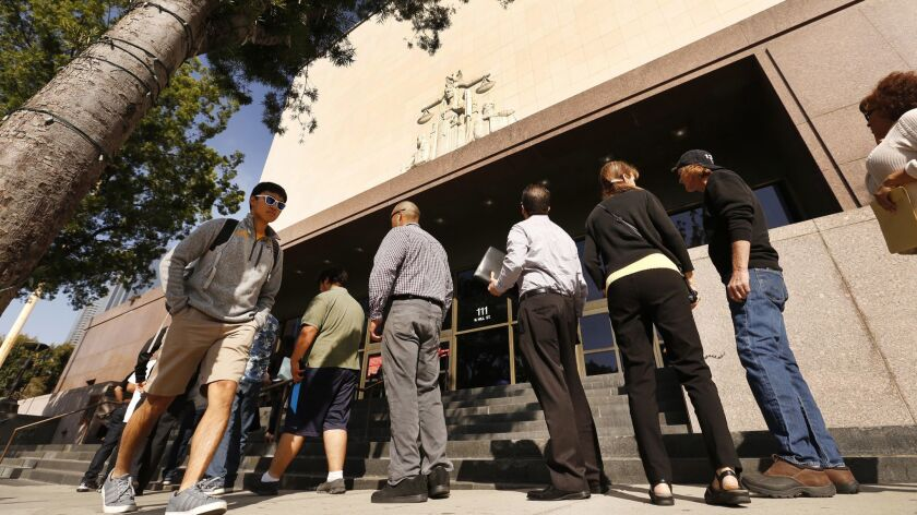 LOS ANGELES, CA - MAY 18, 2017 --A line of people wait to enter the Stanley Mosk Courthouse, which i