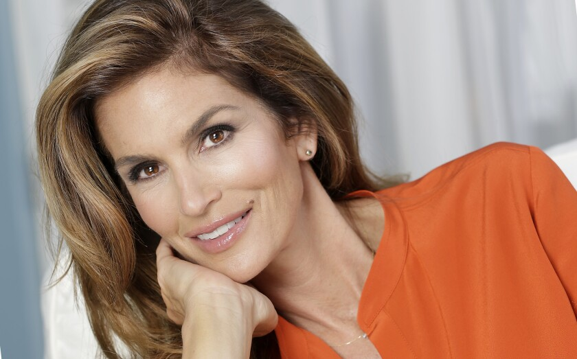 Supermodel Cindy Crawford clarifies remarks that indicated she would be retiring when she turns 50 this month.