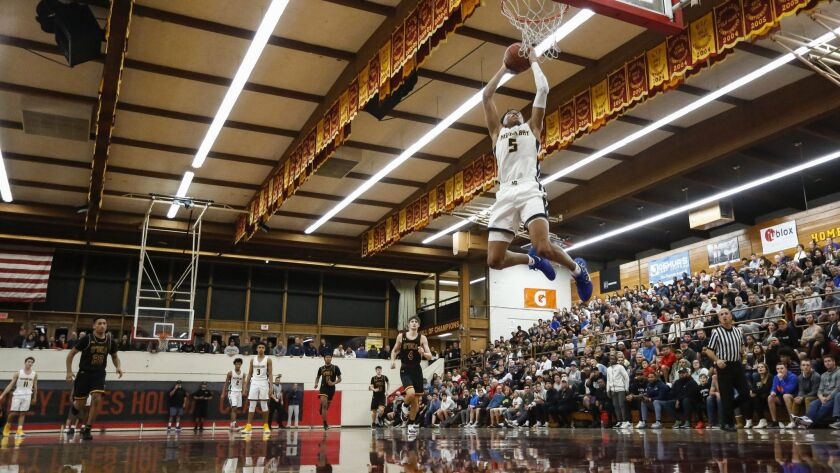 Mission Bay's Boogie Ellis (5) goes up for a dunk in the second period against O'Dea.
