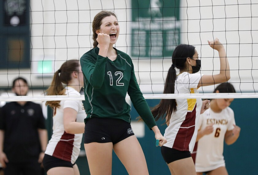 Costa Mesa's Lorelei Hobbis (12) reacts to a point after a long rally against Estancia on Sept. 23.