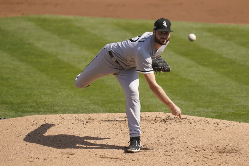 Chicago White Sox pitcher Lucas Giolito throws against the Oakland Athletics.