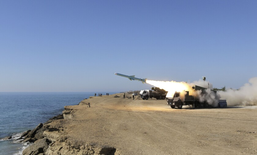 A missile is launched on the shore of the Gulf of Oman during an Iranian navy drill near the port of Jask in 2013.