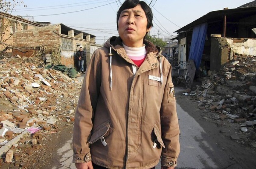 Liu Siping, a 50-year-old migrant, lives in a semi-demolished neighborhood on the outskirts of Beijing. Her rural residency permit, or hukou, limits her access to jobs and social services in cities.