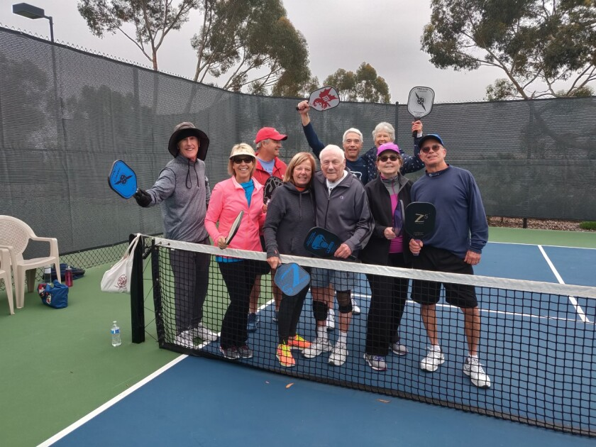 Les Anderson, 94, with fellow pickleball players at the pickleball court in the Candlelight Hills community of Escondido.