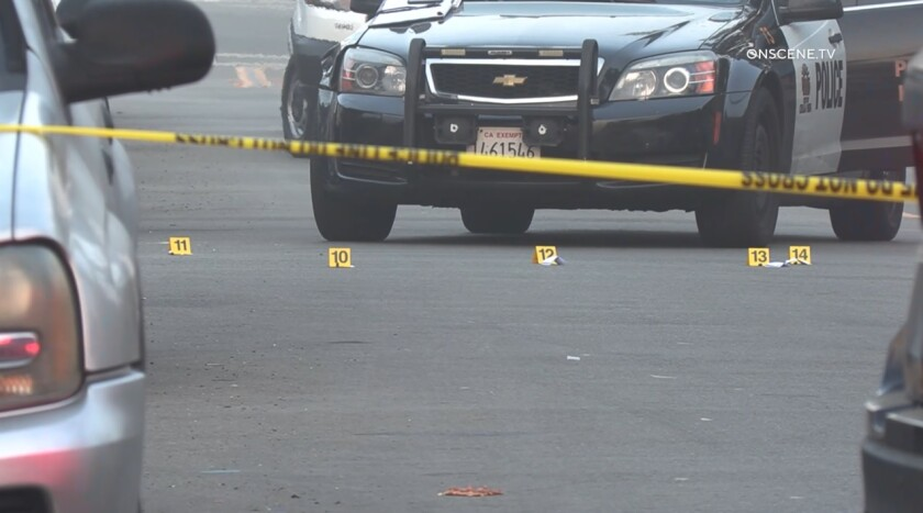 Evidence markers are placed on Chula Vista street where a 32-year-old man was shot early Sunday. He later died at a hospital.