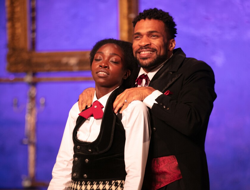 "Bukola Ogunmola as Viola, left, and Gyasi Silas as Orsino in a scene from ""Twelfth Night"" at the Griffith Park Free Shakespeare Festival."