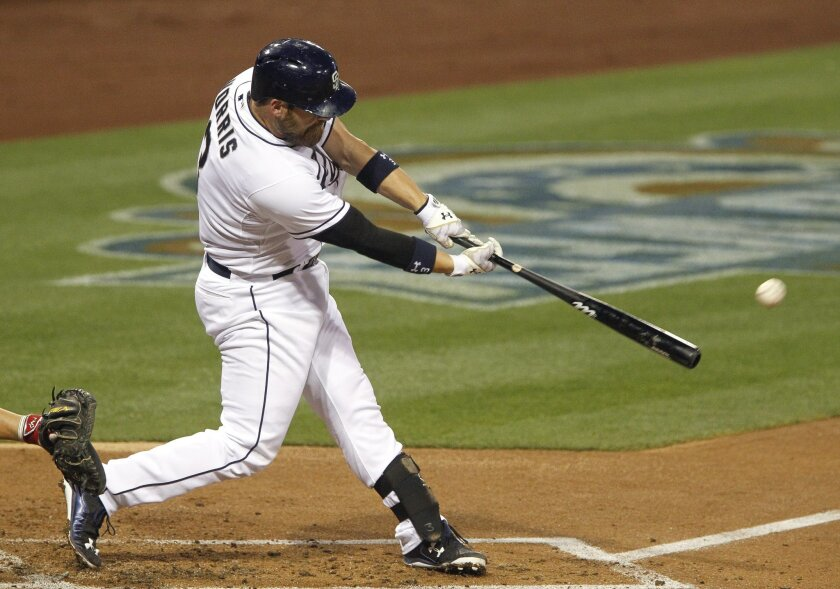 The Padres' Derek Norris hits a one run double in the first inning.