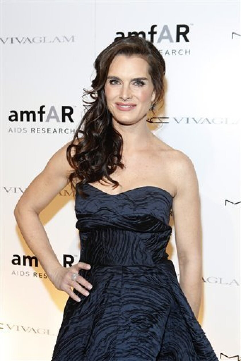 """FILE - In this Feb. 10, 2010 file photo originally released by MAC Cosmetics, actress Brooke Shields attends the amfAR New York Gala in New York.  Shields is set to replace Bebe Neuwith in the role of Morticia in the Broadway Musical, The Addams Family,"""" beginning June 28, 2011. (AP Photo/MAC Cosme"""
