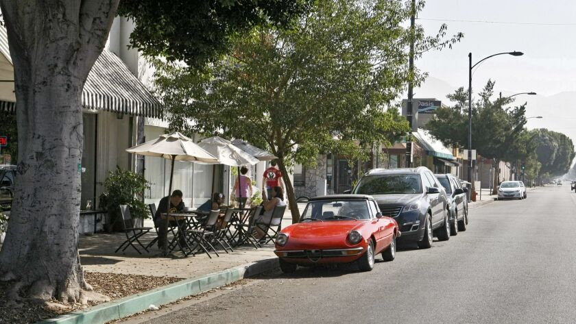 Cars park in front of Romancing the Bean coffee shop on the 3400 block of W. Magnolia Ave. in Burban