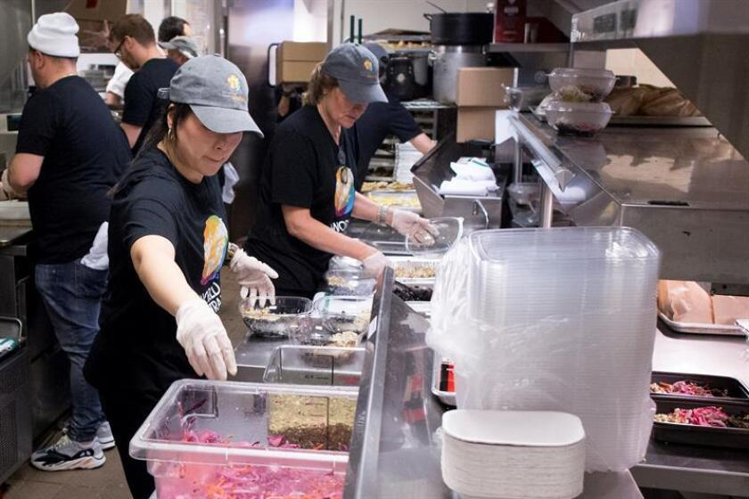 Hundreds of federal workers affected by the partial government shutdown waited in line at a Washington restaurant on Jan. 16, 2019, to receive free soup and sandwiches distributed by volunteers spearheaded by Spanish chef Jose Andres, who provides food to victims of natural disasters. EFE-EPA/ Michael Reynolds