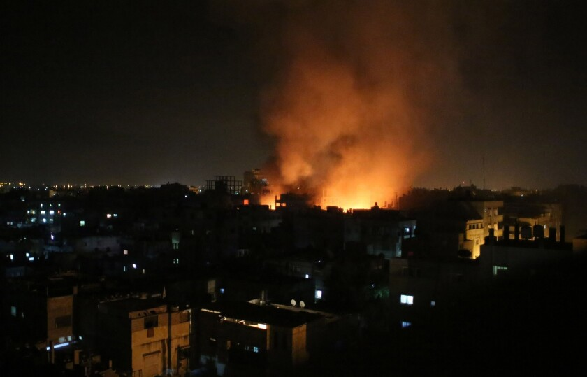 Smoke rises from a shopping center after an Israeli airstrike in the southern Gaza Strip town of Rafah.
