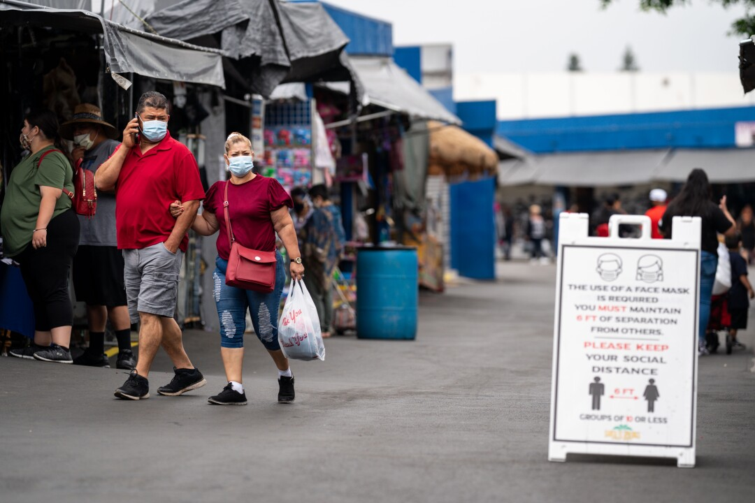 People going to the Santa Fe Springs Swap Meet are required to wear masks and maintain proper social distancing