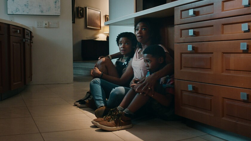"""Ajiona Alexus, left, Gabrielle Union and Seth Carr in the movie """"Breaking In."""""""