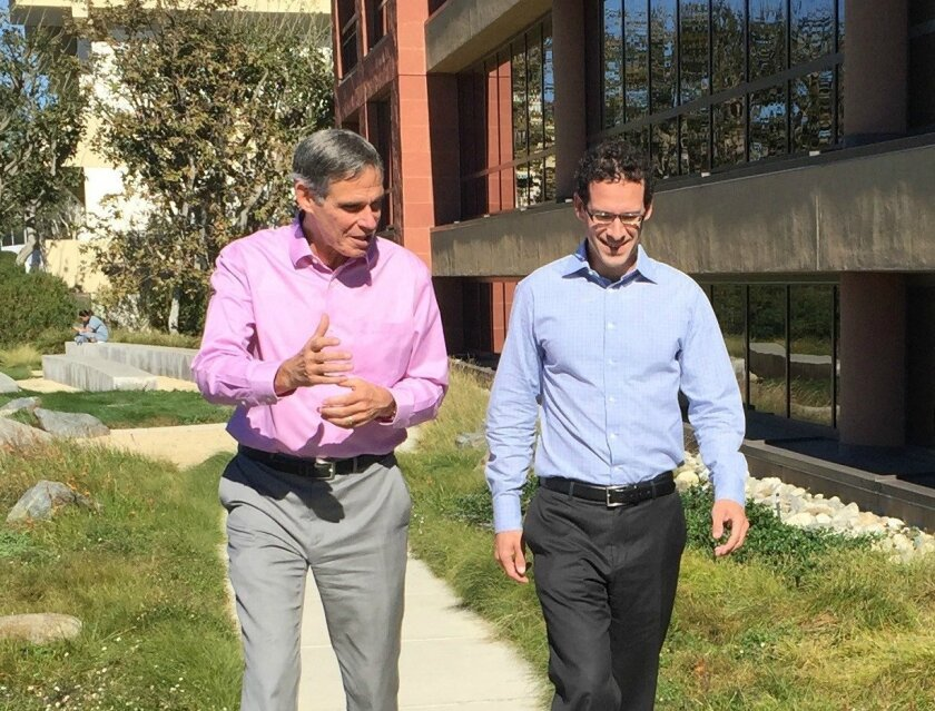 Cardiologist-geneticist Eric Topol (left) and economist-baseball executive Paul DePodesta talk outside of the Scripps Translational Science Institute.