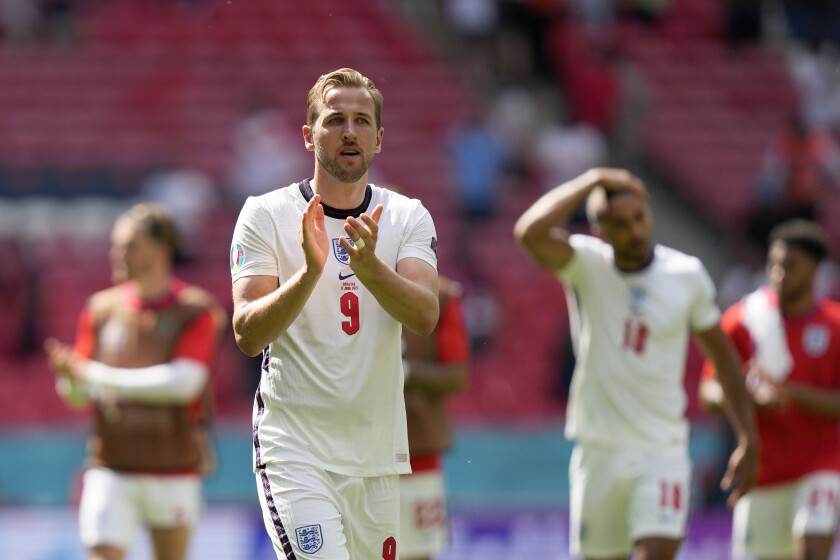 England's Harry Kane, center, applauds at the end of the Euro 2020 soccer championship group D match between England and Croatia at Wembley stadium in London, Sunday, June 13, 2021. England won 1-0. (AP Photo/Frank Augstein, Pool)
