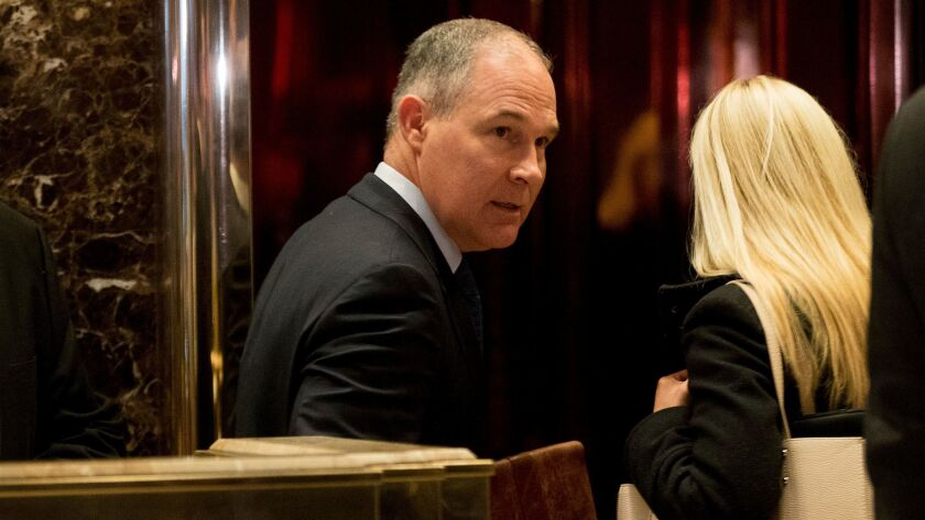 Oklahoma Atty. Gen. Scott Pruitt, a staunch ally of the fossil fuel industry and President-elect Donald Trump's pick to run the Environmental Protection Agency, arrives at Trump Tower in New York on Dec. 7.