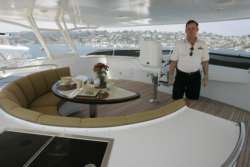 Yacht captain Tyler Flood showed off the flybridge of the Crystal II, a yacht for sale at YachtFest in Shelter Island. (John Gibbins / Union-Tribune)
