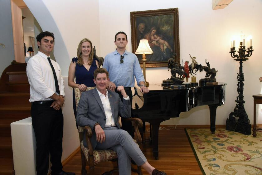Willis Allen Real Estate listing agent Sean Caddell (seated) with his team: social media expert Henry Markell, Erin Figi, and Thomas McBee