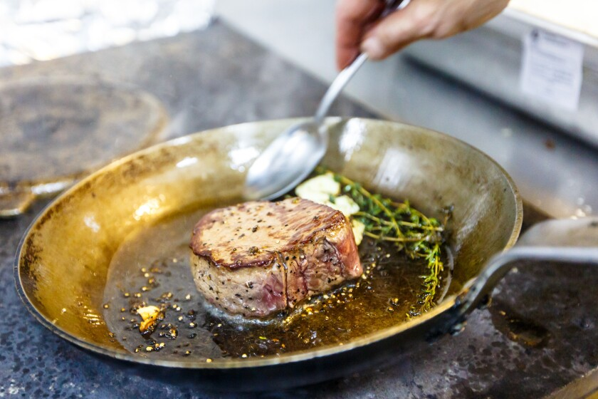 Chateaubriand of beef with rosemary and garlic fried in a skille