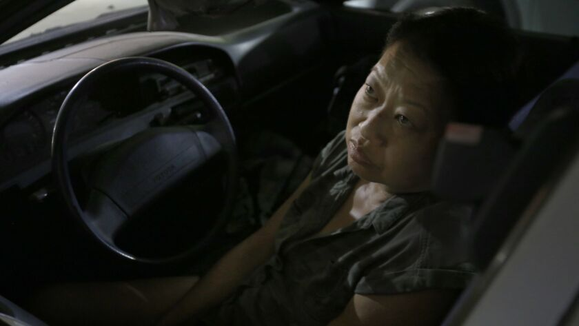 GLENDALE, CA AUGUST 16, 2017: Meg Shimatsu sits in her car in Glendale, CA August 16, 2017. Meg r