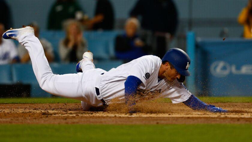 LOS ANGELES, CALIF. - APRIL 03: Los Angeles Dodgers infielder David Freese (25) safely slides into h