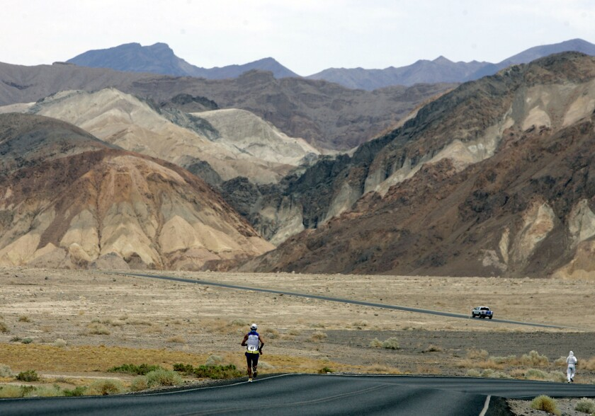 In this July 23, 2007, photo, Valmir Nunes of Brazil runs in the Badwater 135 Ultramarathon in Death Valley. The national park is suspending permits for endurance events, citing safety concerns.