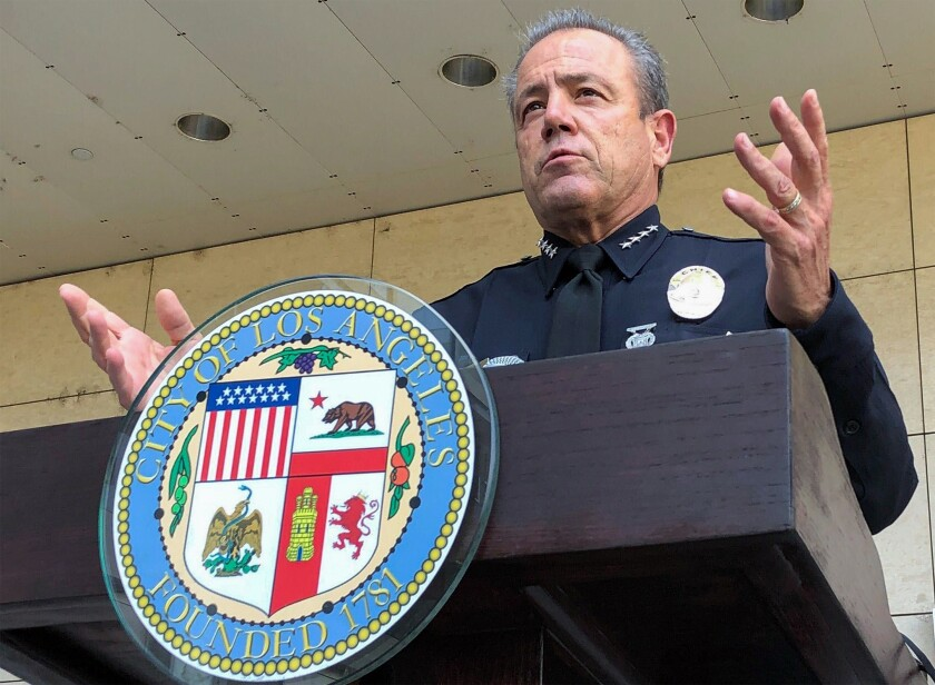 """FILE - In this Aug. 26, 2020, file photo, Los Angeles Police Chief Michel Moore speaks during a news conference outside LAPD headquarters. On Friday, Oct. 2, 2020, Moore called for calm in the streets after a """"spasm of violence"""" in South Los Angeles that has left four dead and more than a dozen wounded in the past five days. (AP Photo/Stefanie Dazio, File)"""